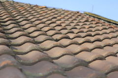 Roof. A red, pointedly roof with bricks Stock Photo
