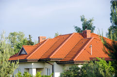 Roof. Of a private house, red tiled and multi surfaced royalty free stock photography