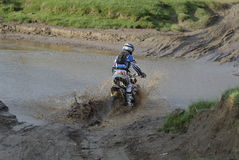 Roof of Africa - Winner - 5 - River crossing. Off road motorcycle race in Lesotho, overall winner - Christopher Birch of New Zealand crossing the Liphiring river Stock Images