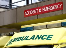 Accident and Emergency sign with ambulance parked underneath. Roof of ambulance parked outside an Accident and Emergency department of a hospital Royalty Free Stock Image