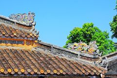 Roof Art In Hue Imperial Tomb of Tu Duc, Vietnam UNESCO World Heritage Site. The imperial tomb of Tu Duc is considered to be the most beautiful Imperial tomb of Stock Images