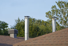 Roof and attic ventilation piping. Stock Photo