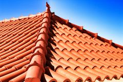 Roof in Azenhas do Mar house with ceramic pigeon on top. Roof in Azenhas do Mar house with beautiful ceramic pigeon on top village outdoor portugal travel royalty free stock photo