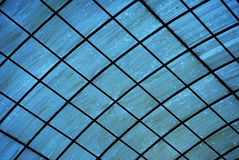 Roof with back light. A blue color artificial roof against a back light Royalty Free Stock Photos