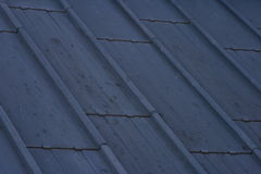 Roof Background. A background of an dark urban wooden roof pattern Stock Photo