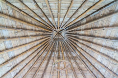 Roof with bamboo and wood. Straw thatched hut roof with bamboo and wood, spa building stock image