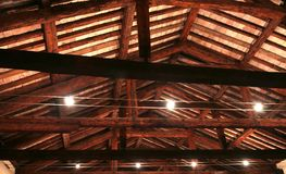 The roof with beams facing bricks and halogen lamps Royalty Free Stock Images