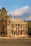 Roof Beams. Sunny Autumnal Evening At The Construction Site Of A Wooden House. Unfinished House. Royalty Free Stock Photos