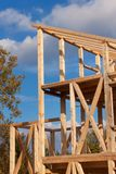 Roof beams. Sunny autumnal evening at the construction site of a wooden house. Unfinished house. Royalty Free Stock Images