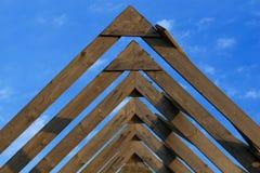 Roof beams under the skies. Wooden roof beams under blue skies Royalty Free Stock Image