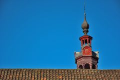 Roof and beautiful classical tower of a church Royalty Free Stock Photos
