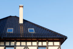 Roof of black glazed ceramic tiles with Dormer Windows and ventilation pipe Stock Photos