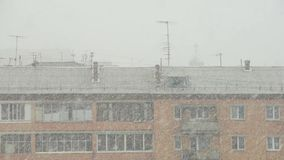 Roof of a block under the snowstorm. In spring time stock video footage