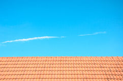 Roof and blue sky background. Stock Photos