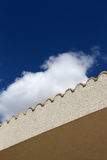 Roof border, with bright cloudy sky Stock Images