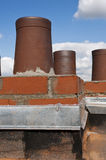 Roof and brick smoke stack Stock Photo