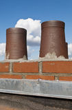 Roof and brick smoke stack Royalty Free Stock Photos