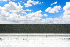Roof and brick wall with blue sky Royalty Free Stock Images