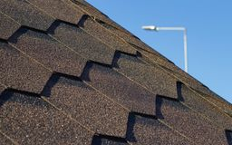 Roof, brown tile against the blue sky stock photography