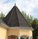 Roof. Brown tiled roof of a modern house Royalty Free Stock Photography