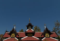 Roof of buddhist temple with deep blue sky background Royalty Free Stock Images