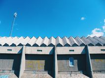 Roof of a building against a blue sky.  Stock Image
