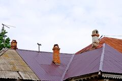 Chimneys on the roof of an old residential building