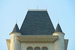 Roof of castle ,shoe rooftile on blue sky background ,. Bottom view Stock Photo
