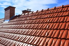 Roof and chimney. Roof chimney brick detail architecture red colour wall royalty free stock image