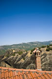 Roof and chimney. Meteora monastery, Greece. Famous destination place of tourists. View from the viewpoint stock image