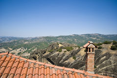 Roof and chimney against mountains landscape. Meteora monastery, Greece. Famous destination place of tourists. View from the viewpoint stock photos