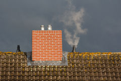 Roof and chimney against background of bad weather Royalty Free Stock Photo