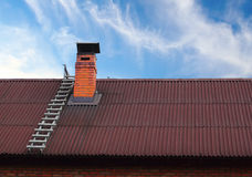 Roof Chimney And A Ladder Royalty Free Stock Image