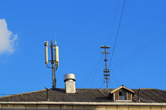 Roof with chimney and antennas Royalty Free Stock Images