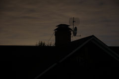 Roof and chimney in the evening Royalty Free Stock Image