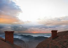 Roof with chimney and landscape sky Royalty Free Stock Images