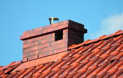 Roof with chimney, modern ceramic tile Stock Photos