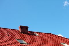 Roof with chimney, modern ceramic tile Stock Image