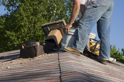 Roof Chimney Repair, Home Maintenance House Fix. House chimney has been torn down and rests on the roof as the structure is being repaired. One of many aspects Stock Image