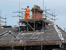 Roof and Chimney Repair. Work being done on a home in a residential neighbourhood in Yorkshire, England royalty free stock photos