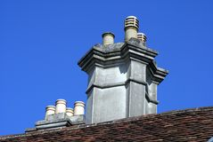 Roof with chimney stacks and chimney pots Stock Photos