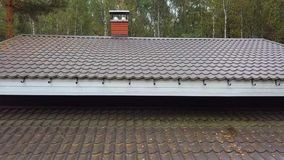 Roof and chimney. Video of a modern building roof and chimney stock footage