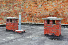 Roof chimneys Stock Images
