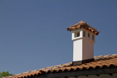 Roof with chimneys. And blue sky Stock Images