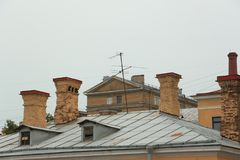 Roof chimneys. Brick chimneys on the roof Royalty Free Stock Photos