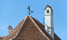 Roof with chimneys and wind vane Royalty Free Stock Image
