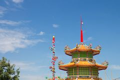 The roof of a Chinese shrine with the sky in the background. The sky is blue with some cloud. This is typical Chinese shrine roof royalty free stock photos
