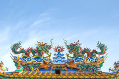 The roof of Chinese shrine. Is Two dragon statues With Blue Sky royalty free stock photography