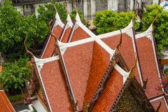 Roof with Cho Fa finials on Buddhist Temple. Cho Fa or Chofa finials on roof of Buddhist Temple royalty free stock photo