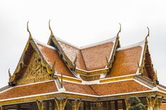 Roof with Cho Fa finials on Buddhist Temple. Cho Fa or Chofa finials on roof of Buddhist Temple stock photo